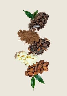Kreatywna kompozycja ze zdrowym składnikiem organiczne produkty kakaowe ziarna w proszku masło czekolada na