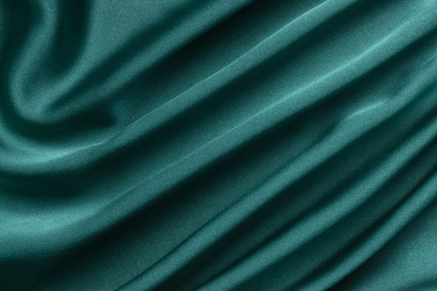 Kreatywne tło zielonego jedwabiu. streszczenie tekstura.