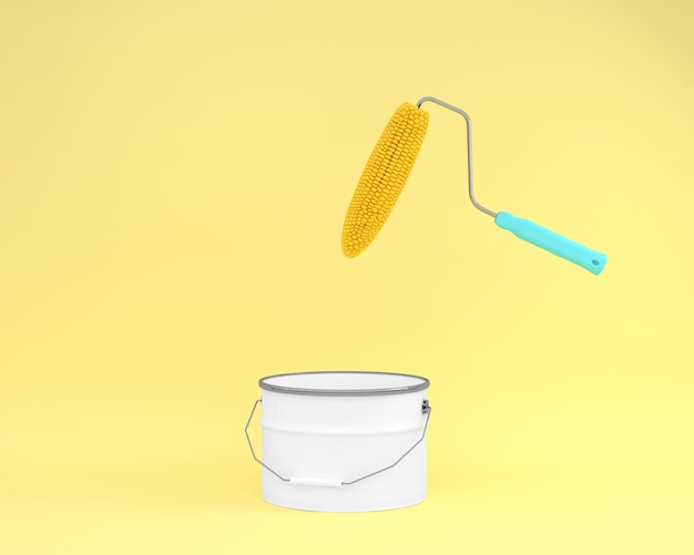 Kreatywnie układ rolkowa farby kukurudza unosi się na żółtym tle z białym farby wiadrem