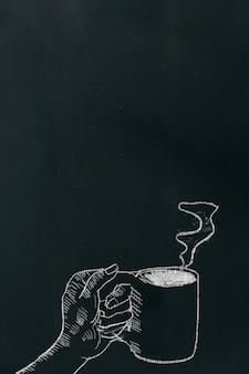 Kredowa ręka rysuje rękę trzyma filiżankę z kontrparą na czerni desce