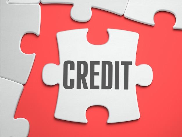 Kredyt - puzzle na miejscu brakujących elementów.