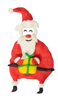 Kreskówka zabawa santa z prezentem na białym tle. grafika dla dzieci.