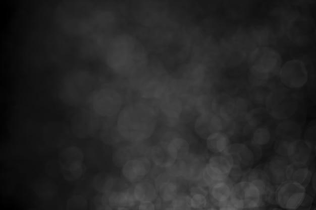 Kropka wody bokeh czarno-białe na tle