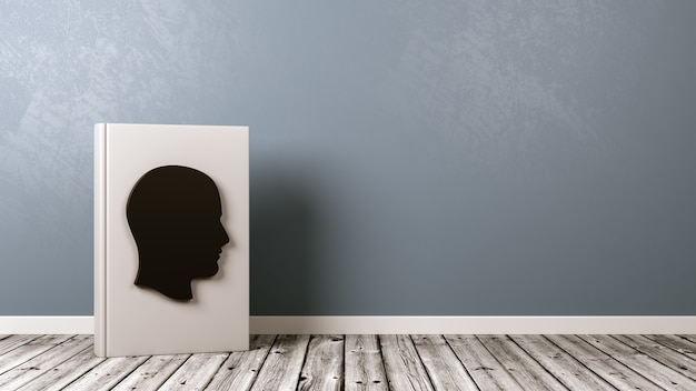 Książka w kształcie ludzkiej głowy na drewnianej podłodze pod ścianą