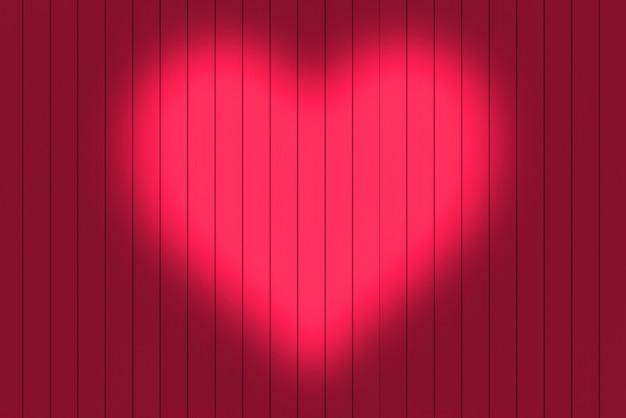 Kształt serca światło na czerwonym tle ściany panelu drewna.