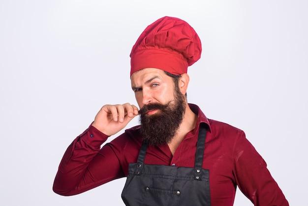 Kucharz człowiek w mundurze szefa kuchni profesjonalny kucharz człowiek gotowanie zawód kucharz biznesowy kucharz piekarz w kapeluszu