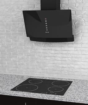 Kuchenka indukcyjna z aspiratorem przed ceglaną ścianą