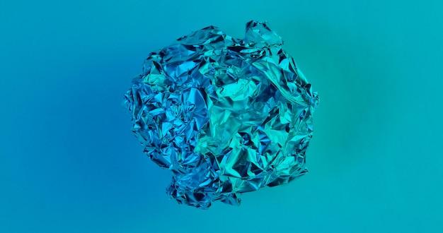 Kulka zmiętego papieru. holograficzne niebieskie światło. widok z góry, surrealizm