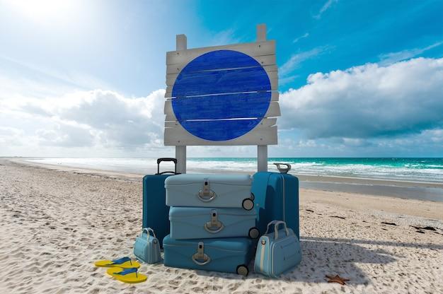 Kupie bagaż i drewniany znak na tropikalnej plaży
