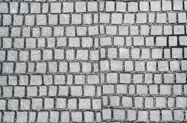 Kwadratowy stary brukowiec rock płytki chodnik wzór tła podłogi