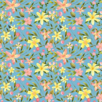Kwiatowy wzór na niebieskim tle botaniczny nadruk powtarzalny projektowanie kwiatów i liści