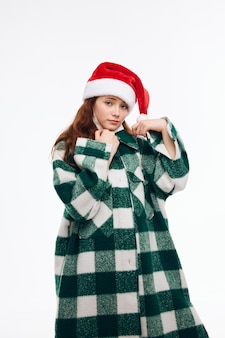 Ładna dziewczyna nowy rok ubrania wakacje boże narodzenie atrakcyjny wygląd jasnym tle