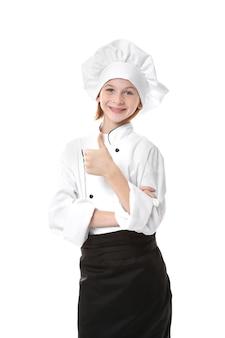 Ładna dziewczyna w mundurze szefa kuchni na białym tle