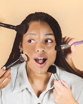 Ładny makijaż afrykańskiej kobiety z pędzlem, makijaż pół twarzy