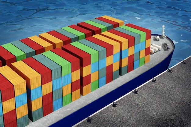 Ładowanie pomarańczowego kontenera na statek towarowy w porcie