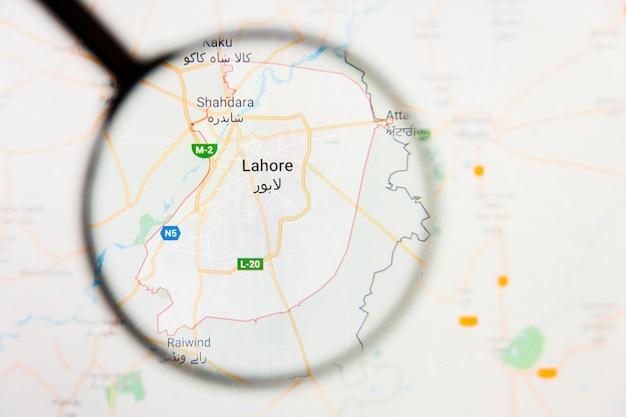 Lahore, pakistan wizualizacja miasta koncepcja na ekranie wyświetlacza przez szkło powiększające