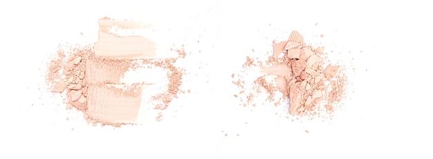 Łamany zmielony beżowy twarz proszek odizolowywający na białym, odgórnym widoku ,.