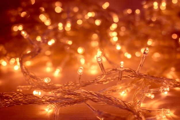 Lampki choinkowe girlanda zamazana żarówka led jasnożółty oświetlenie bokeh