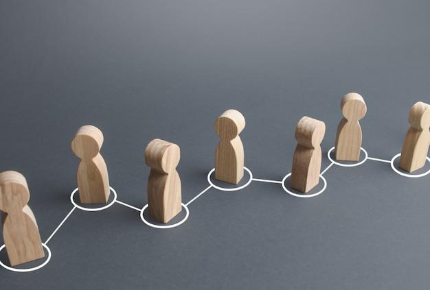 Łańcuch połączonych ludzi liniami. współpraca, współpraca. łącza komunikacyjne