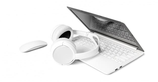 Laptop i hełmofon odizolowywający na bielu