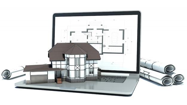 Laptop i rysunki z projektem domu