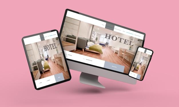 Latający laptop, telefon komórkowy i tablet renderowania 3d przedstawiający responsywny projekt sieci web hotelu. ilustracja 3d