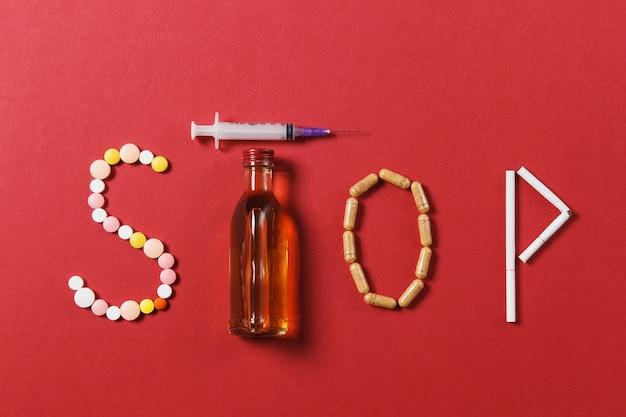 Lekarstwa białe okrągłe tabletki w słowie stop
