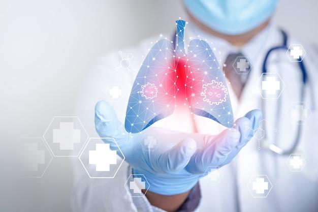 Lekarze w maskach i rękawiczkach przedstawia graficzny interfejs komputera podłączony do sieci medycznej.
