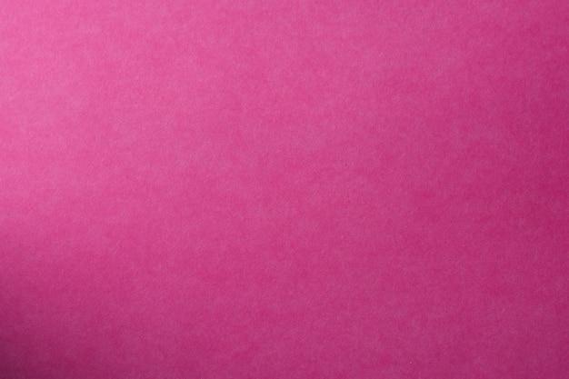 Lekka różowa papierowa tekstura dla tła