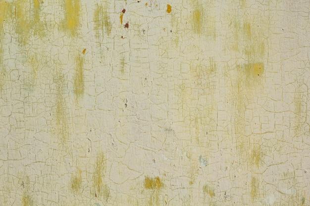 Lekka tekstura koloru pistacjowego z pęknięciami na starej farbie