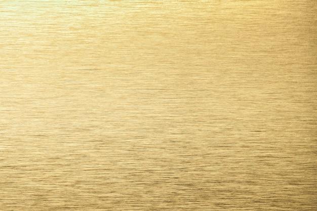 Lekkie złote aluminiowe tekstury tła. żółte tło metalowe tekstury stali.