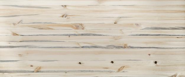 Lekkiego beżowego drewnianego biurka tła tekstury szalunku deski stołu tabletop nieociosana drewniana powierzchnia pusty czysty stołowy chodnikowiec z kopii bezpłatną przestrzenią dla teksta, odgórny widok