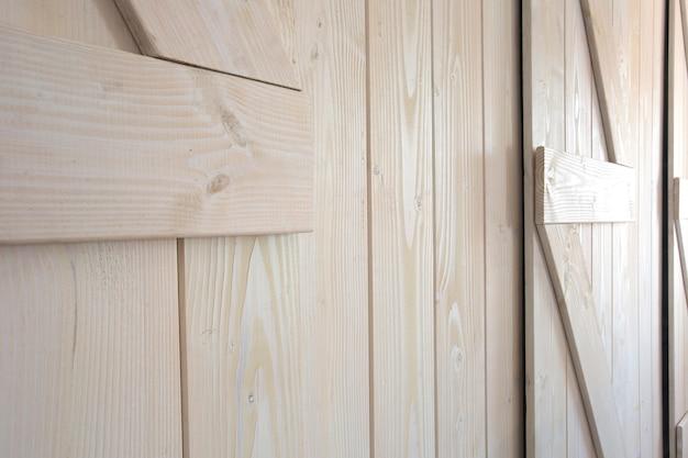 Lekkiej drewnianej stajni drzwi tła tekstury nowożytny wewnętrzny zakończenie
