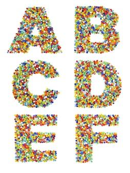 Litery alfabetu od a do f wykonane z kolorowych szklanych koralików na białym tle