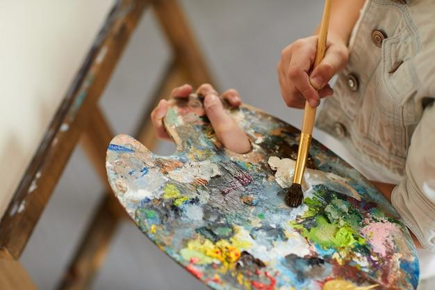 Little girl holding palette
