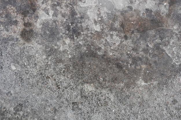 Lód naturalny z pęknięciami. mroźna tekstura. sezon zimowy. zdjęcie wysokiej jakości