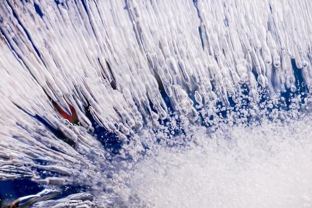 Lodowa tekstura. sekcja lodowa z bąbelkami, tlen w zamarzniętej wodzie.
