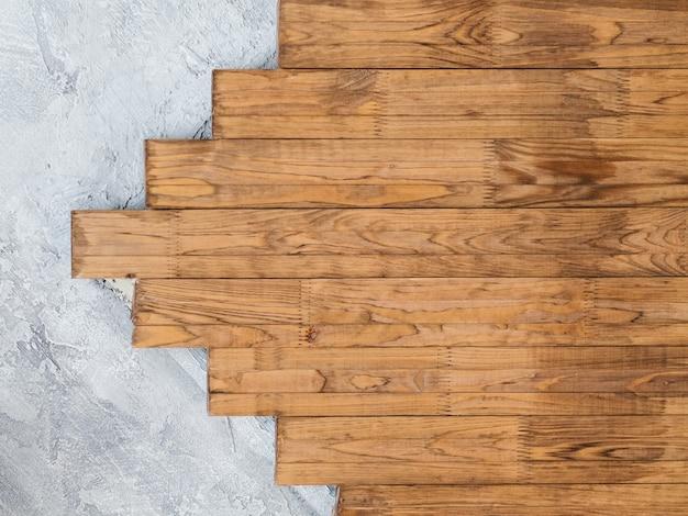 Loft tle ściany. wzór tynku strukturalnego i drewna. nowoczesny minimalizm wystroju.