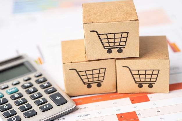 Logo koszyka na zakupy na pudełku z kalkulatorem na wykresie.