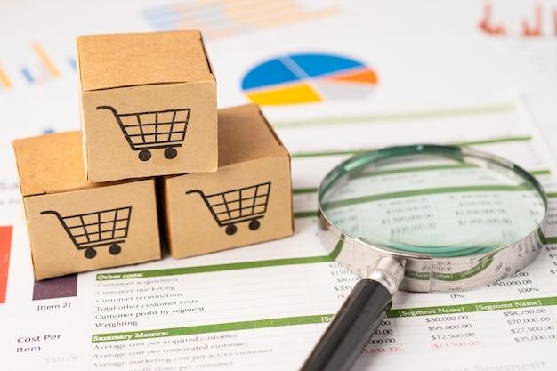 Logo Koszyka Na Zakupy Na Pudełku Z Lupą Na Wykresie Premium Zdjęcia