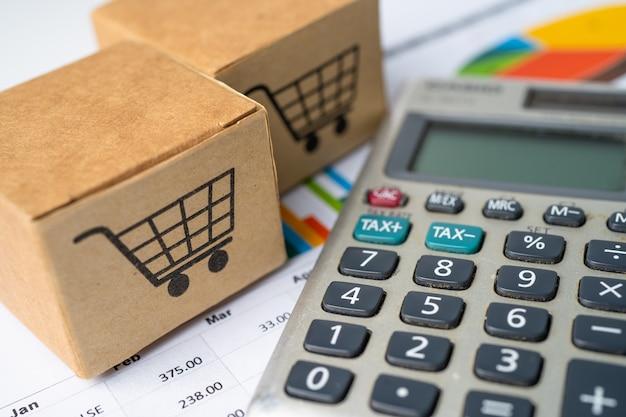 Logo koszyka na zakupy w pudełku z kalkulatorem na tle wykresu.