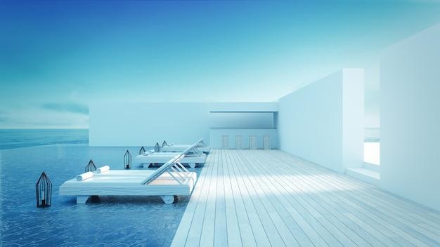 Lounge na plaży - sundeck na widok na morze na wakacje i lato