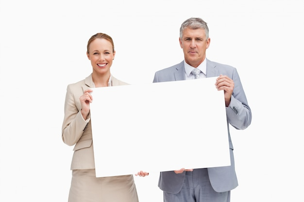 Ludzie biznesu trzyma plakat