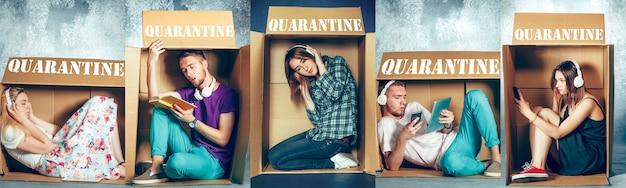 Ludzie poddawani kwarantannie rozprzestrzeniania się koronawirusa - siedzący w małych pudełkach, pozostający w koncepcji domu. mężczyźni i kobiety próbujący prowadzić aktywność, zachowując izolację. zapobieganie pandemii wirusa grypy.