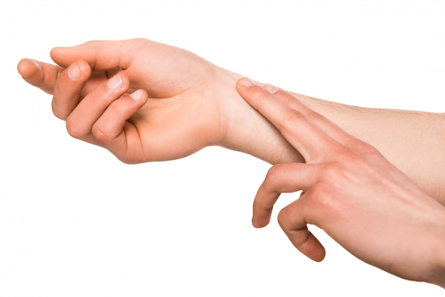 Ludzka ręka pomiar pulsu ramienia