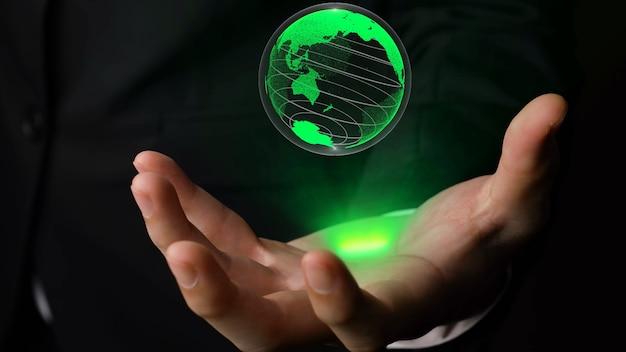 Ludzka ręka trzyma technologię holograficzną kuli ziemskiej