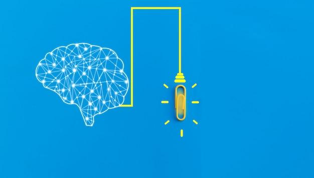 Ludzki mózg i spinacz połączone ze sobą