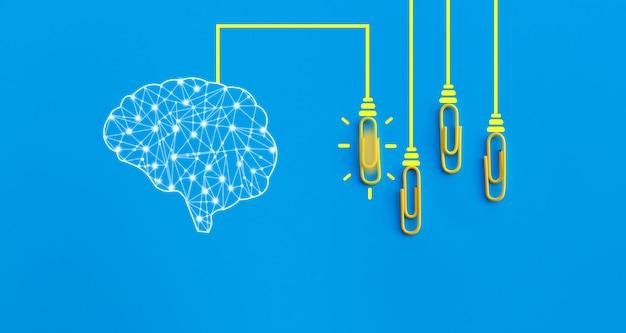 Ludzki mózg i spinacze połączone ze sobą