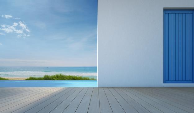 Luksusowy basen z widokiem na morze w nowoczesnym białym domu na plaży.