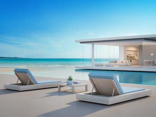 Luksusowy dom na plaży z basenem i tarasem z widokiem na morze w nowoczesnym stylu.